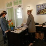 Programs Coordinator Kristen Fogle waiting at the front desk to greet the first guests
