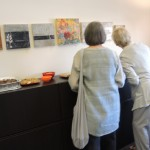 Visitors enjoy the art and the snacks